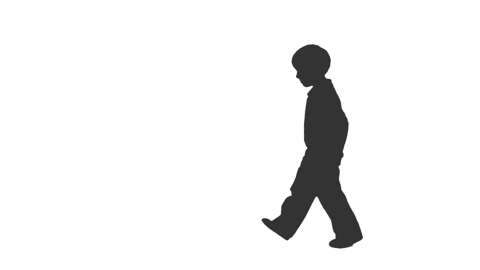 1920x1080 Silhouette Of A Little Boy Walks Forward And Backward. Side View