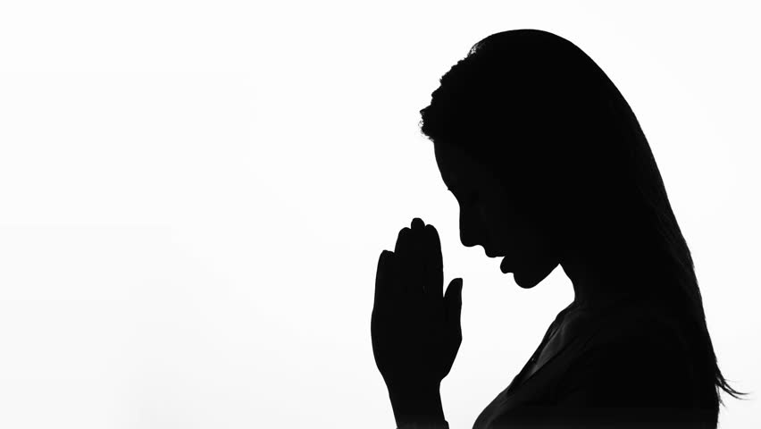 852x480 Performing Five Time Prayer Silhouette Of A Muslim Praying. Woman