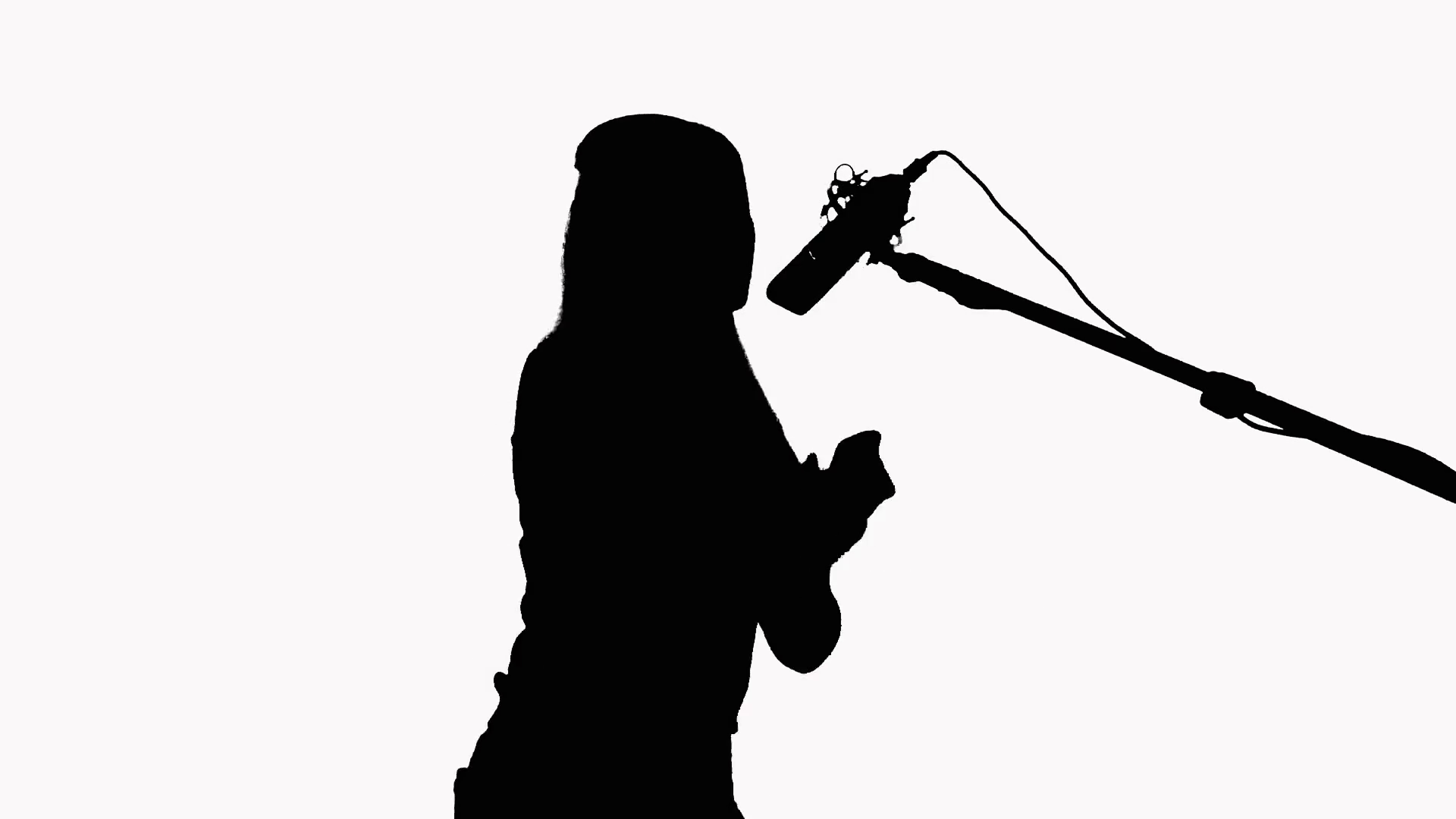 1920x1080 Silhouette Of A Girl With Long Hair Who Sings Into A Studio