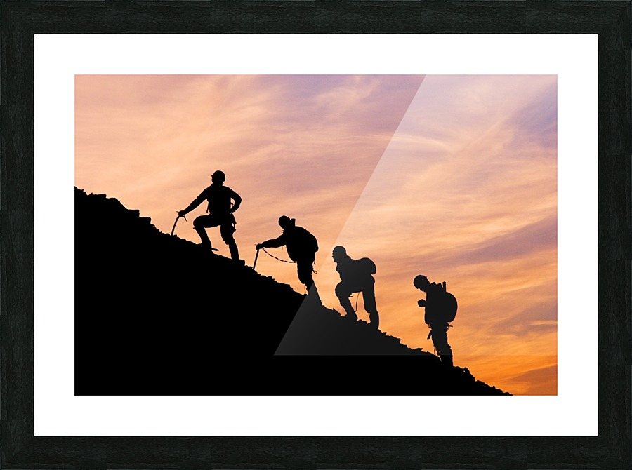 900x670 Silhouette Of Four Mountian Climbers As They Ascend Mount
