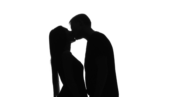 590x332 Real Feelings Of Love, Two Lovers Kissing. Silhouette. White By