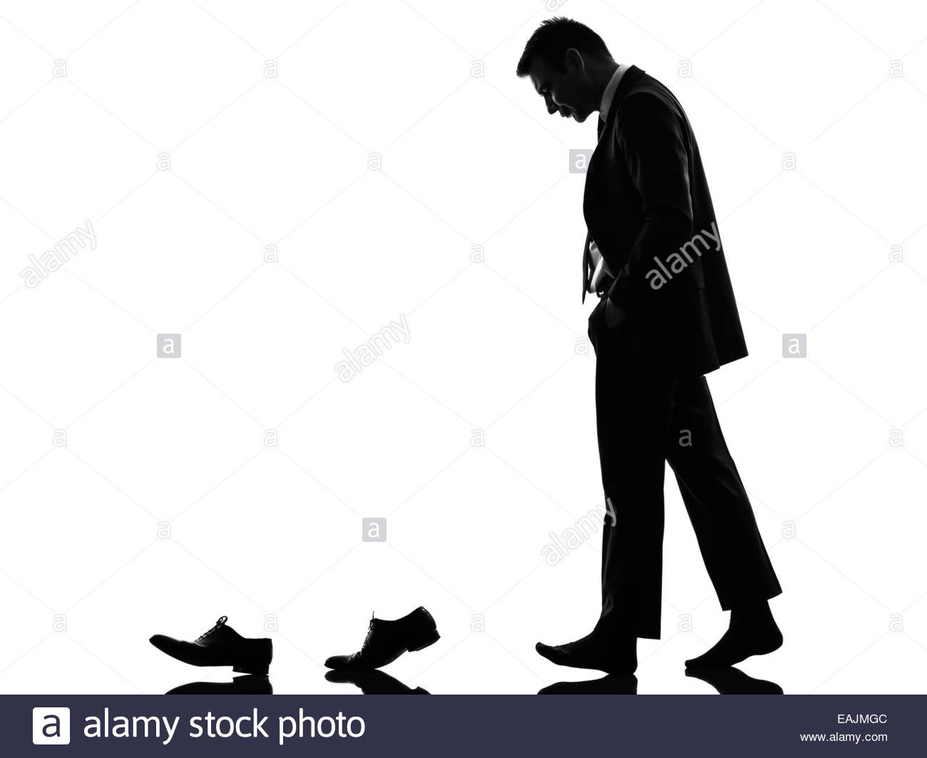 1300x1063 One Caucasian Business Man Walking Behind His Shoes In Silhouette