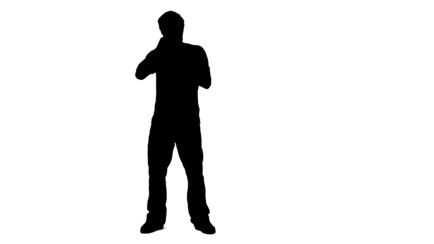852x480 A Silhouette Man Is Singing Into A Microphone Against A White