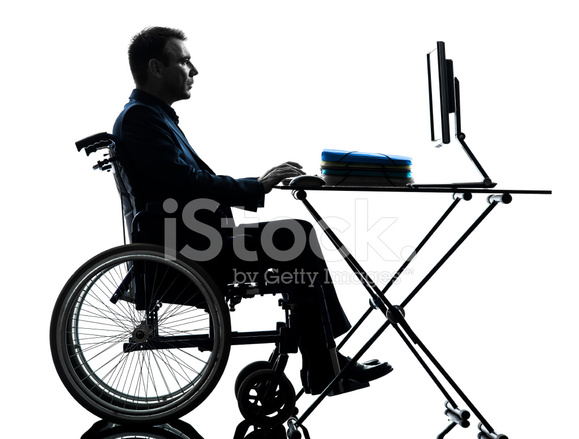 579x439 Handicapped Business Man Computing Laptop Computer In Wheelchai