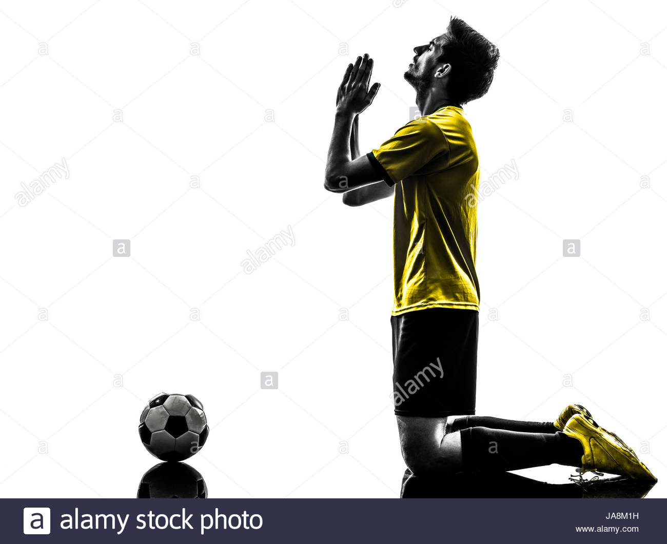 1300x1061 One Brazilian Soccer Football Player Young Man Praying