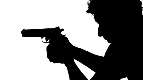 480x270 Man Shoots With A Gun Silhouette ~ Stock Video