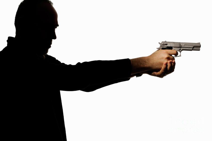 900x600 Silhouette Of Man Holding Gun Photograph By Sami Sarkis