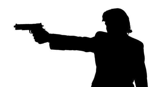 600x338 Silhouette A Man Raising His Gun And Aiming Down The Sights