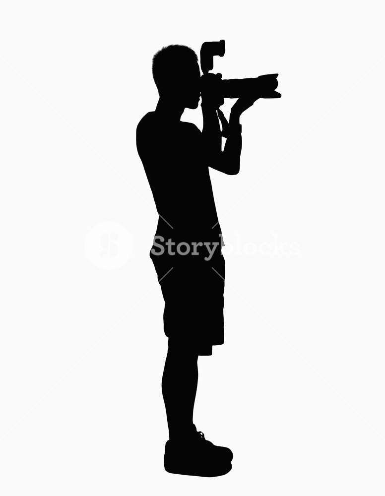776x1000 Silhouette Of Man Holding Camera. Royalty Free Stock Image