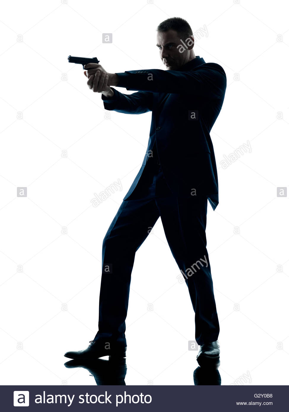 975x1390 One Caucasian Man With A Handgun Silhouette Isolated On White