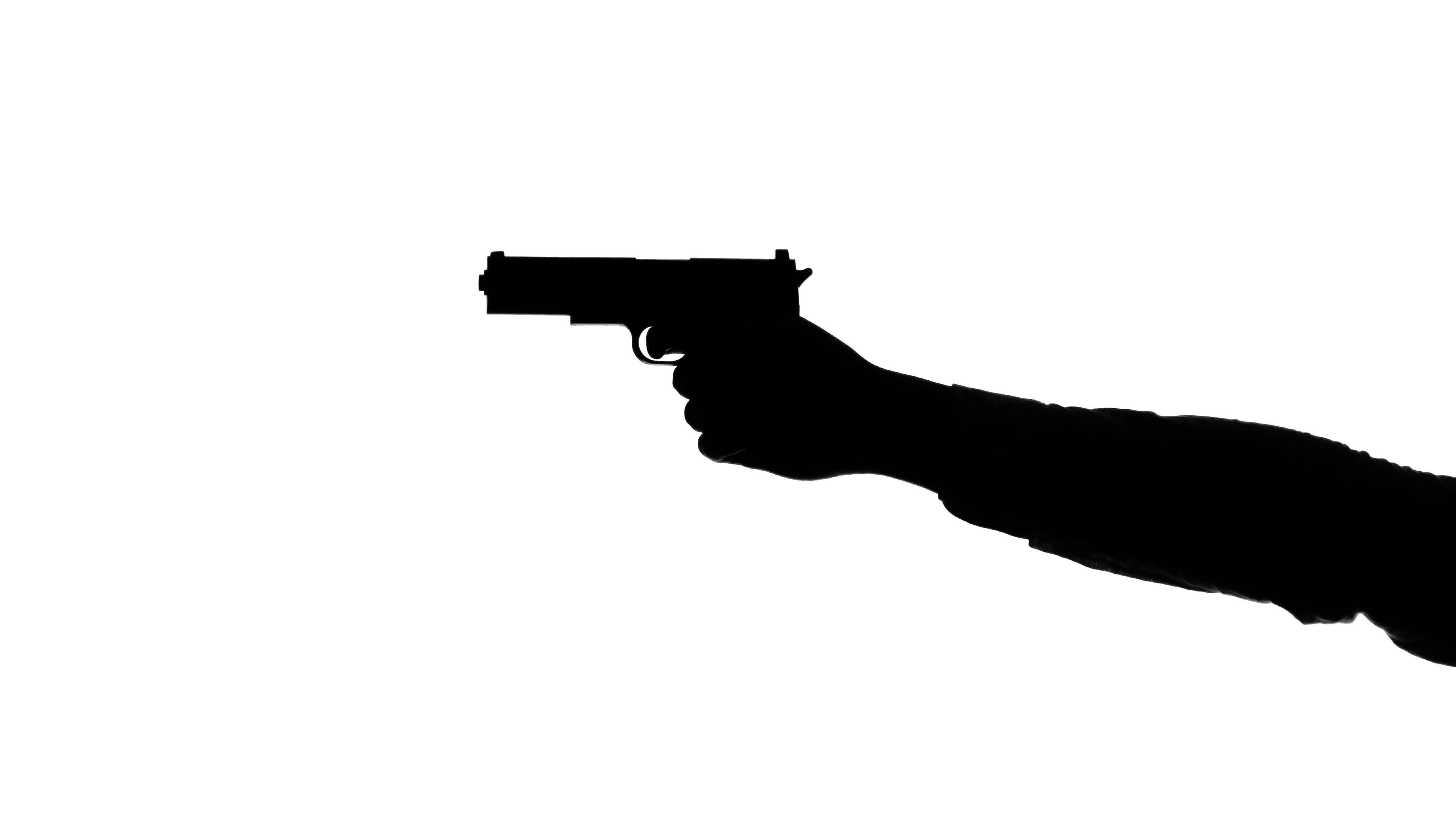 3840x2160 Hands Loading A Gun And Shooting. Silhouette. White Stock Video