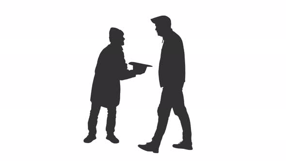 590x332 Silhouette Of A Beggar Gets A Coin From A Man Walking By By Mgpremier