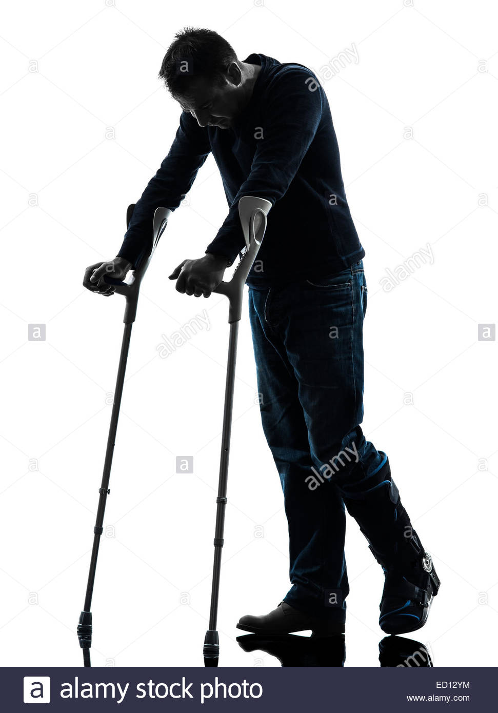 971x1390 One Man Injured Man Walking Sad With Crutches In Silhouette Studio