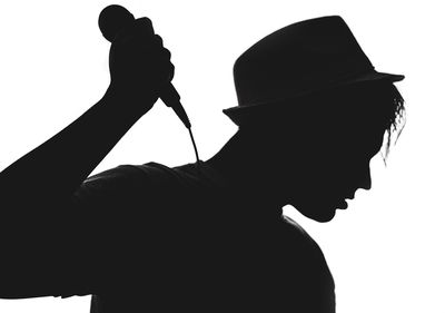 400x281 Free Photo Of Silhouette Of A Young Man With Hat And Microphone