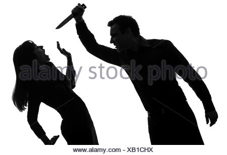 450x308 One Couple Man Killing Woman With Knife In Silhouette Studio Stock