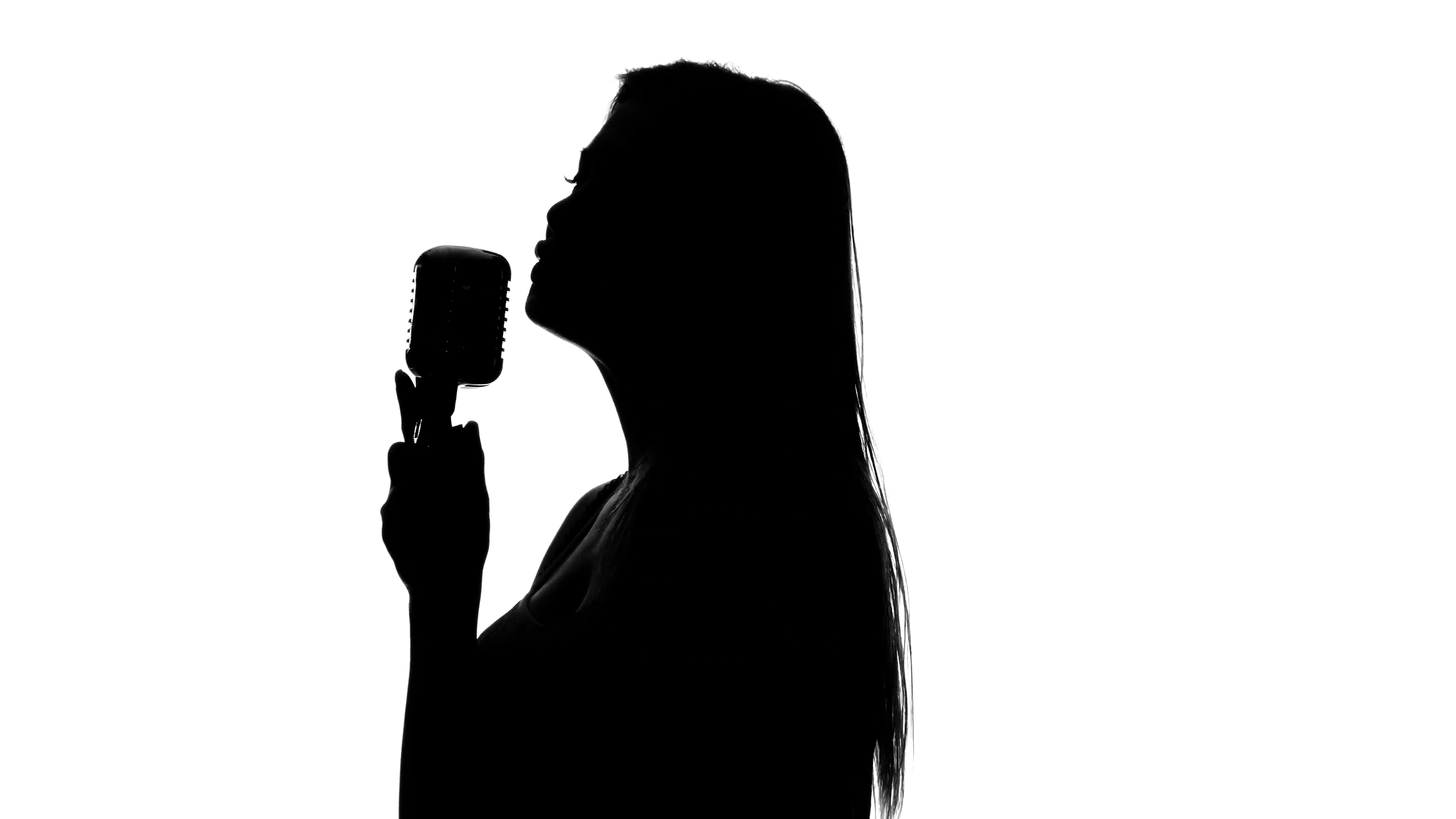 3840x2160 Singer Leads To A Counter With A Microphone. Close Up. Silhouette