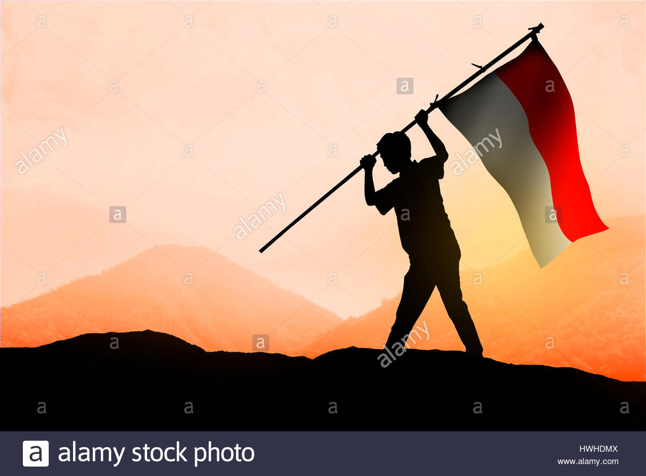 1300x958 Successful Silhouette Man Waving Indonesian Flag On Top