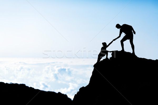 600x400 Man And Woman Help Silhouette In Mountains Stock Photo
