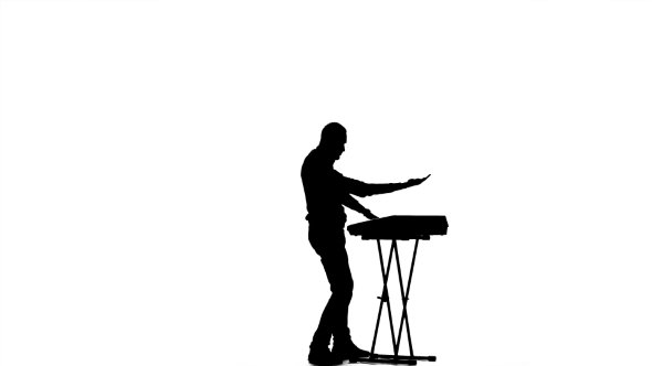590x332 Man Playing Fast Music Synthesizer. Silhouette On A White