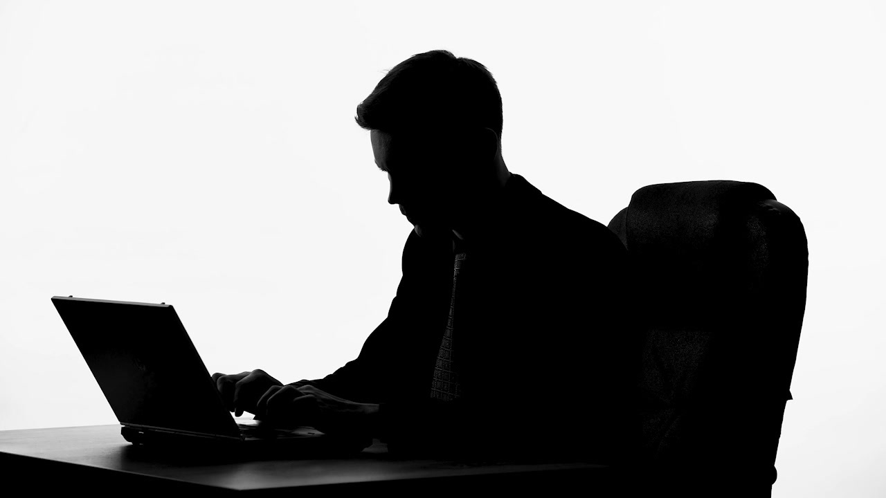 1280x720 Black And White Silhouette Of Man Reading Good News On Laptop