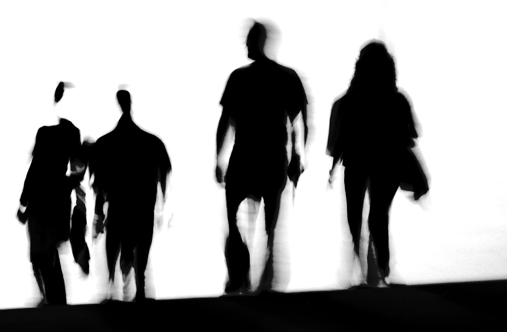 1024x670 People Walking Silhouettes Away