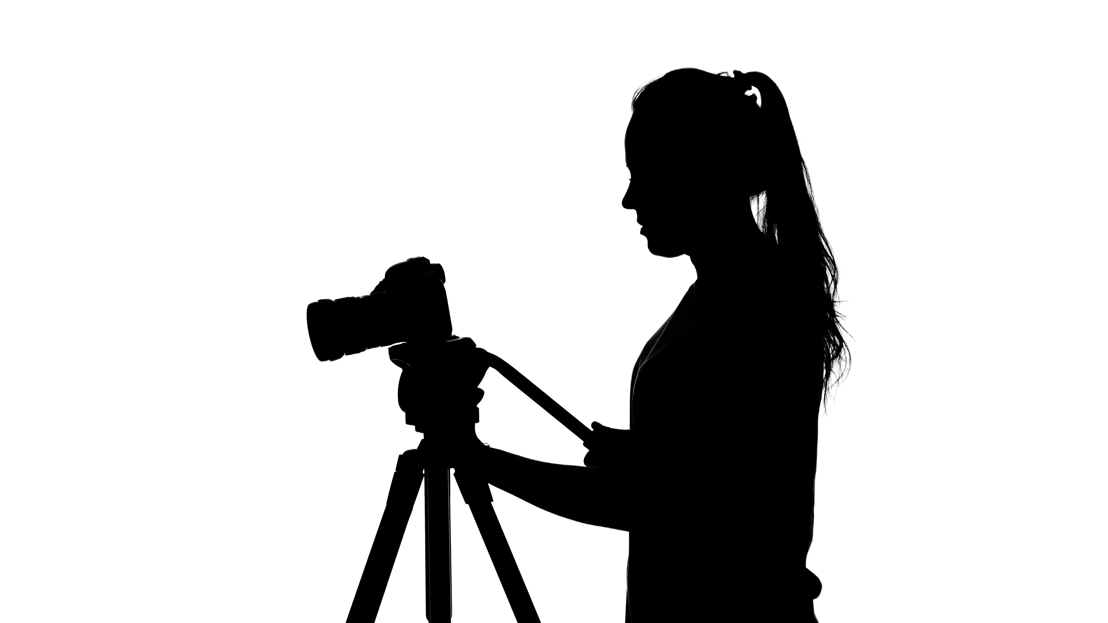 3840x2160 Photographer Works With A Tripod. White. Silhouette Stock Video