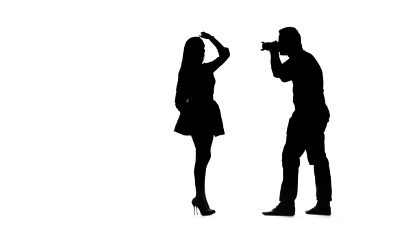 590x332 Model Girl Posing For A Photographer. Silhouette. White Background