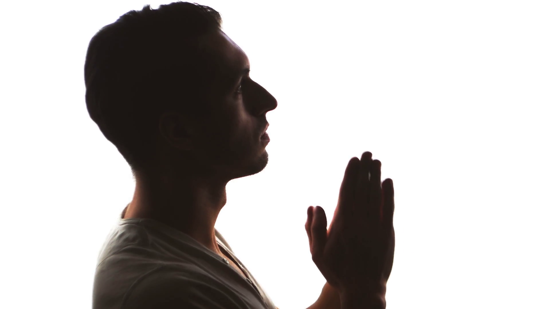 1920x1080 Silhouette Of A Man Hand Praying, Close Up Stock Video Footage