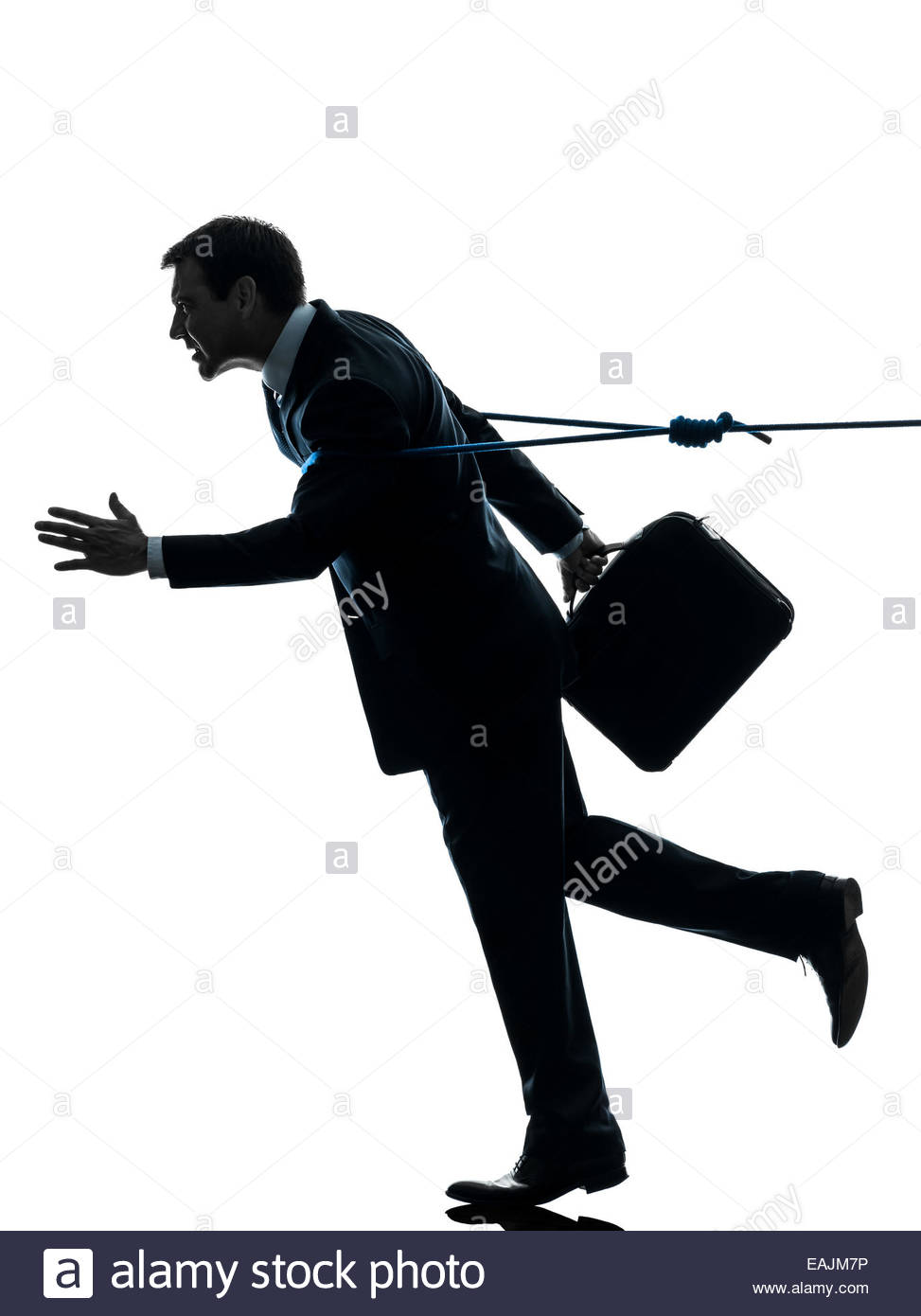 973x1390 One Business Man Catched By Lasso Rope In Silhouette Studio