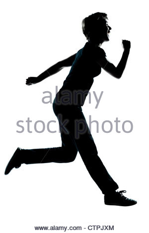 300x470 Silhouette Of Happy Teenager Boy Running On The Shore Stock Photo