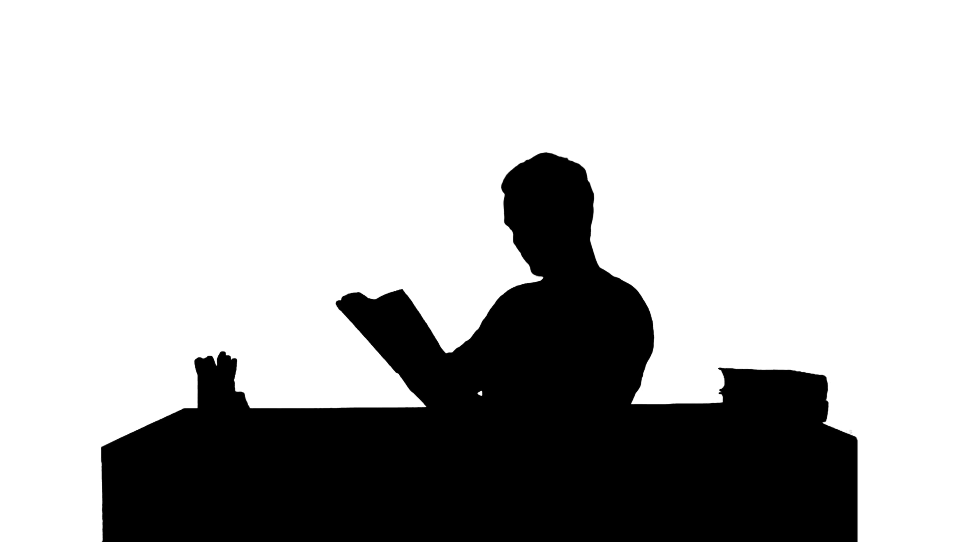 3840x2160 Silhouette Portrait Of A Male Student Reading A Book Stock Video