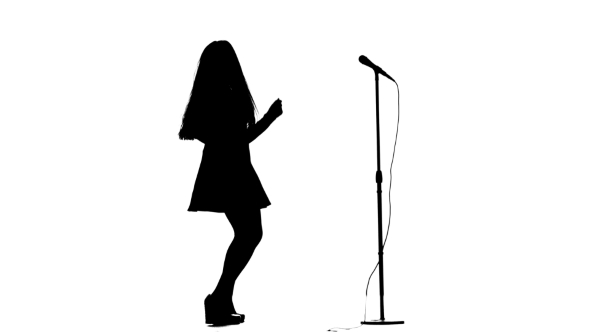 590x332 Actress In A Retro Microphone Sings A Rock Song. White Background