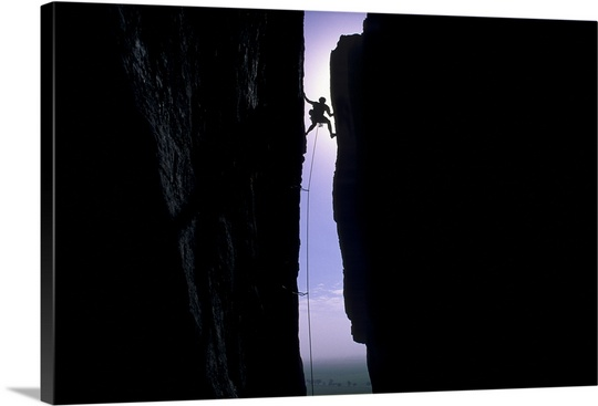 540x367 Silhouette of man rock climbing in chasm Wall Art, Canvas Prints