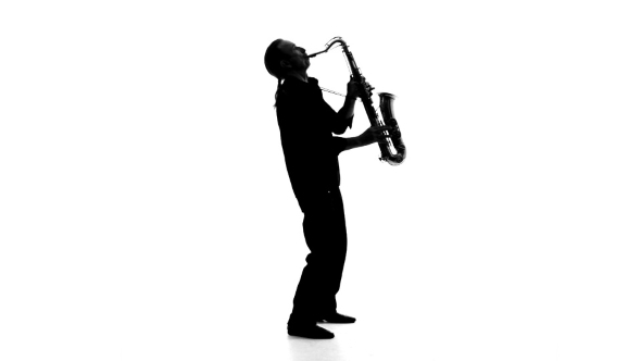 590x332 Silhouette Of A Musician Who Plays The Saxophone By Lovevision