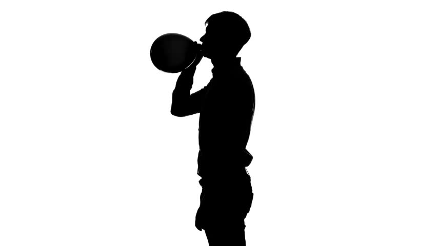 852x480 Man Is Inflating An Air Balloon And Ties It. Silhouette. White