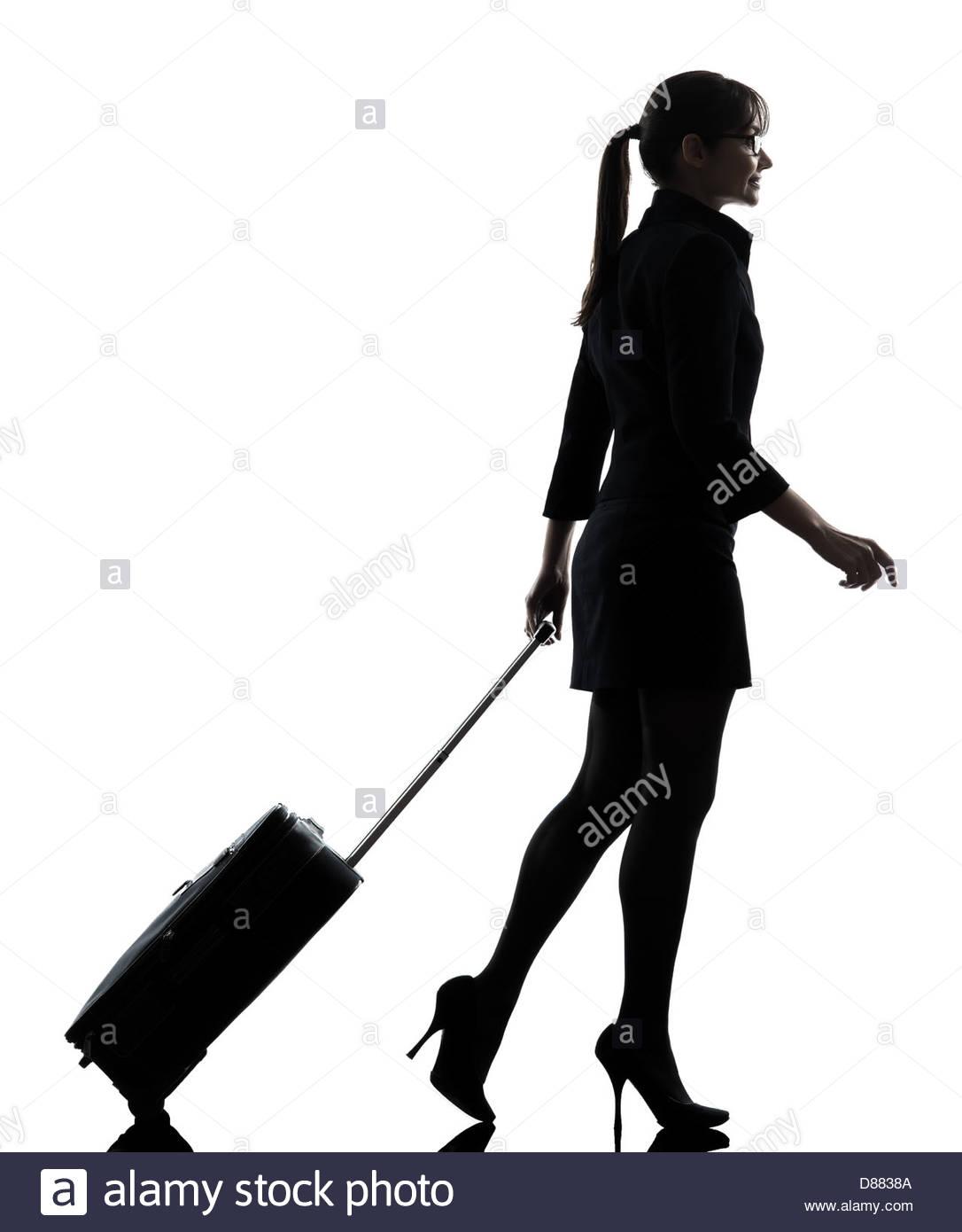 1086x1390 One Business Woman Traveler Walking Suitcase Silhouette Studio