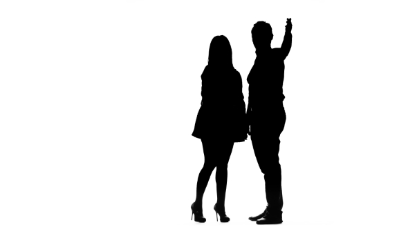 590x332 Couple In Love Is Waiting For Friends And Waving