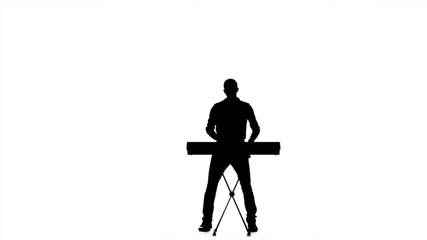 852x480 Silhouette Of A Man Playing On Electronic Keyboard. Slow Motion