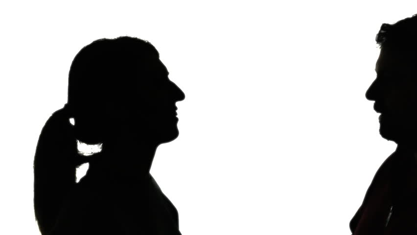 Silhouette Of A Man And Woman Kissing