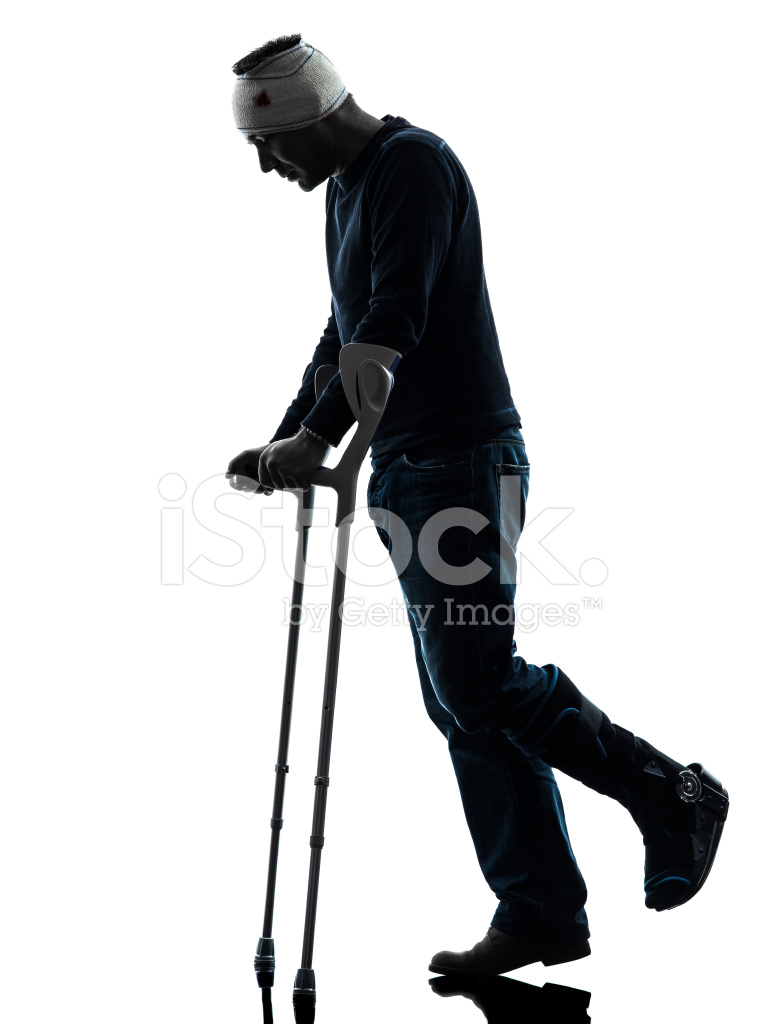 765x1024 Injured Man Walking Sad With Crutches Silhouette Stock Photos