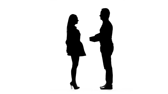 590x332 Guy Gives A Gift To His Beloved Girl. Silhouette. White Background