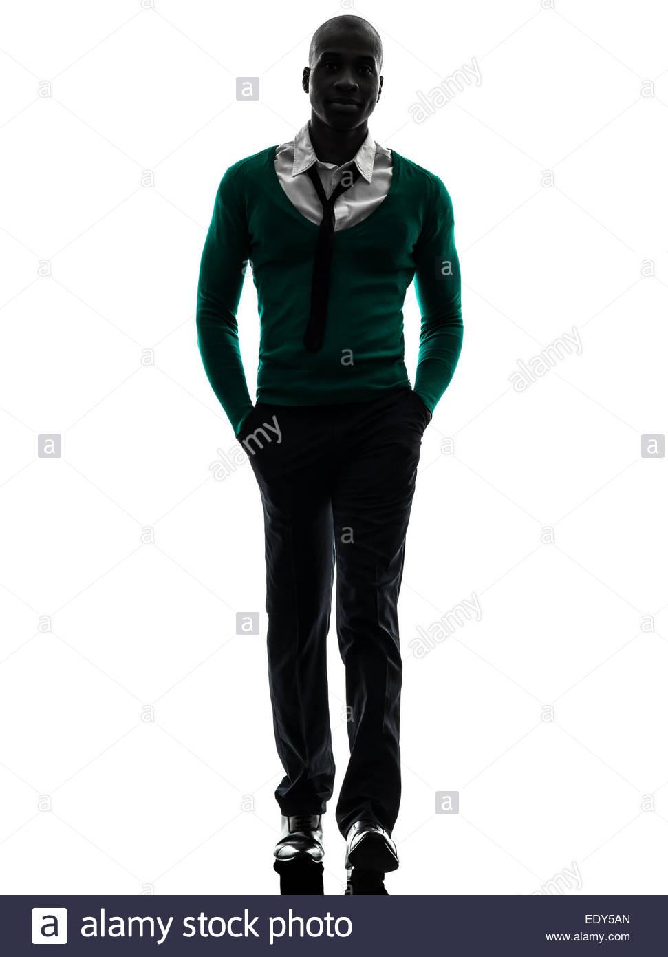 971x1390 One African Black Man Walking In Silhouette Studio On White Stock