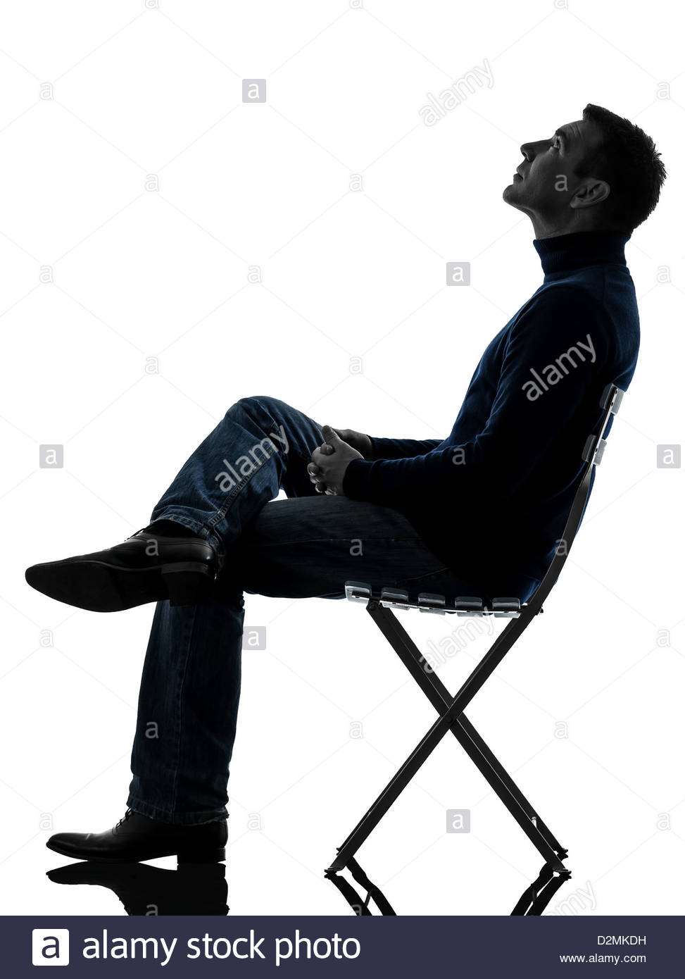 973x1390 One Man Sitting Looking Up Full Length In Silhouette Studio