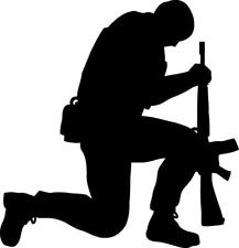 Silhouette Of Soldier Kneeling