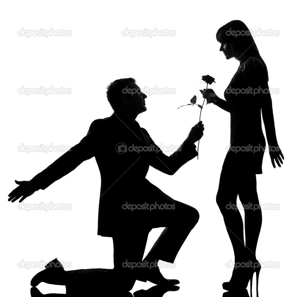 1024x1024 Depositphotos 11294742 One Couple Man Kneeling Offering Rose