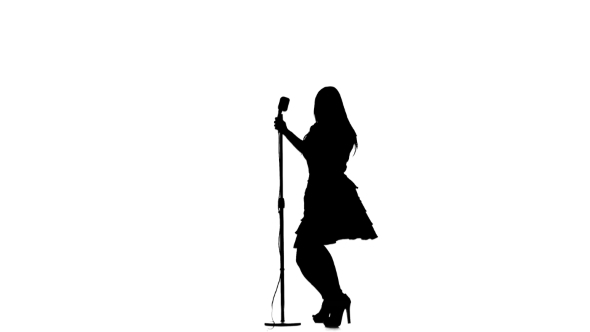 590x332 Silhouette Of Woman Singing A Song And Dancing Near A Retro