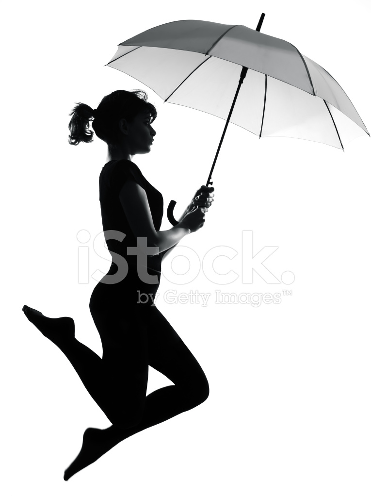 765x1024 Silhouette Woman Flying Holding Open Umbrella Stock Photos