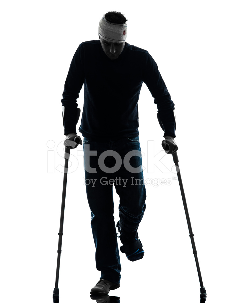 765x1024 Injured Man Walking With Crutches Silhouette Stock Photos
