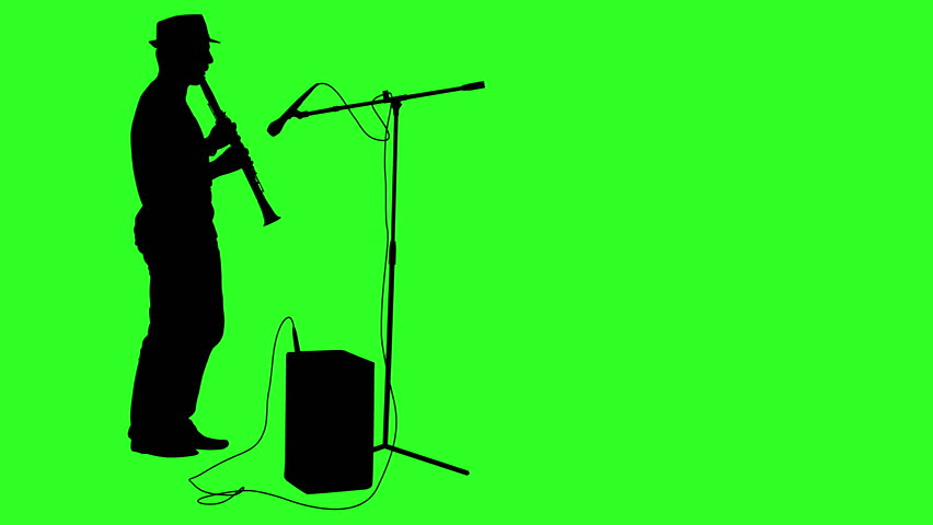852x480 Silhouette Of A Man Who Makes A Stand With A Microphone On
