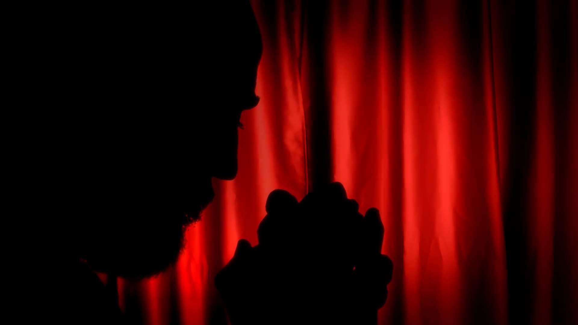 1920x1080 Silhouette man praying red curtain. A man praying God with a